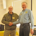 Bruce receives the Rotarian of the Month award from Prez John.