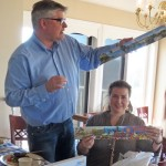 Visiting Rotarians Carsten and Susanne Zehm share gifts with our club.